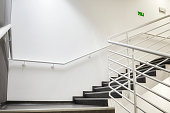 Modern empty staircase with white wall as to be found in an office, hospital or an apartment.