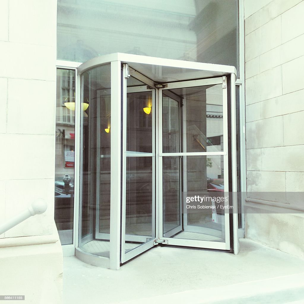 Modern Entrance With Revolving Door & Revolving Door Stock Photos and Pictures | Getty Images Pezcame.Com