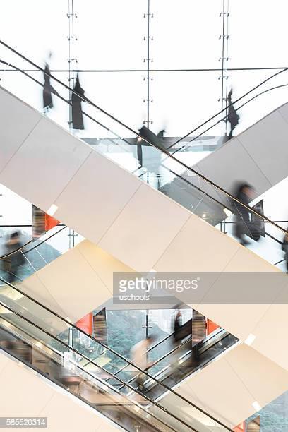 Modern Escalator with blurred people
