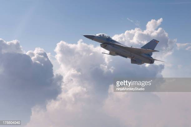 Modern F-16 fighter plane flying above the clouds