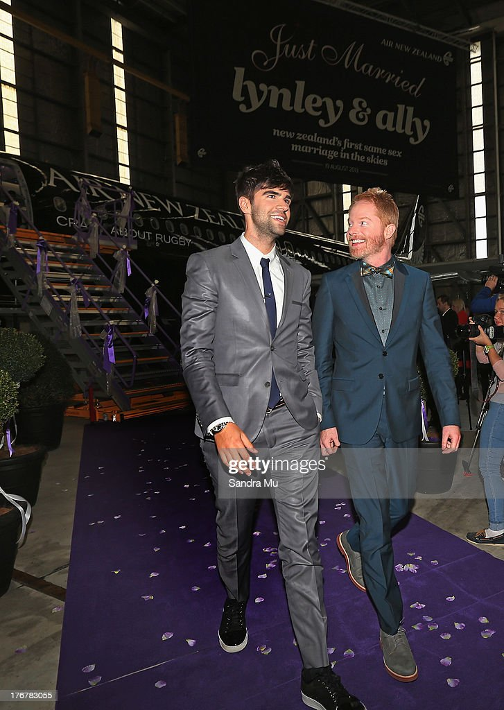 Modern Family actor <a gi-track='captionPersonalityLinkClicked' href=/galleries/search?phrase=Jesse+Tyler+Ferguson&family=editorial&specificpeople=633114 ng-click='$event.stopPropagation()'>Jesse Tyler Ferguson</a> (R) and his husband <a gi-track='captionPersonalityLinkClicked' href=/galleries/search?phrase=Justin+Mikita&family=editorial&specificpeople=7458663 ng-click='$event.stopPropagation()'>Justin Mikita</a> arrive for the reception at the Air New Zealand hanger on August 19, 2013 in Auckland, New Zealand. New Zealand passed a bill to legalize same-sex marriage as of August 19, 2013. New Zealand is the first coutry in Oceania to leaglize same-sex marriage.