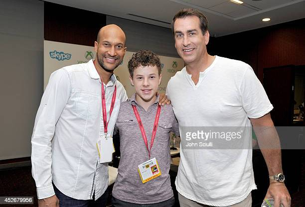 'Modern Family' actor Nolan Gould poses with 'Let's Be Cops' actors KeeganMichael Key and Rob Riggle in the Microsoft VIP Lounge during ComicCon on...