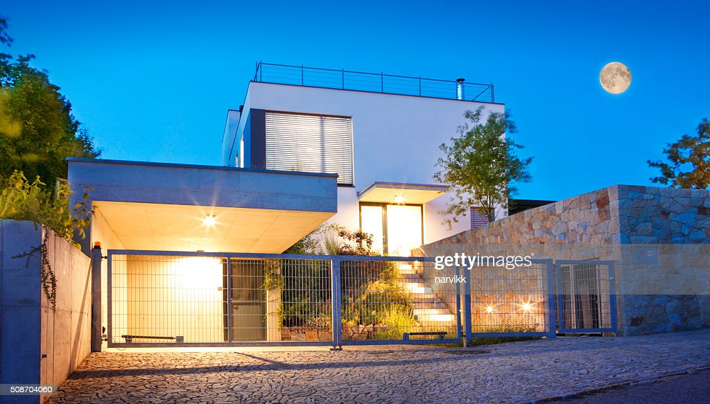 Modern Family House Exterior By Twilight Stock Photo Getty Images