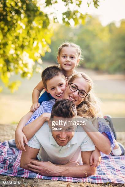 Modern family on the pile in nature