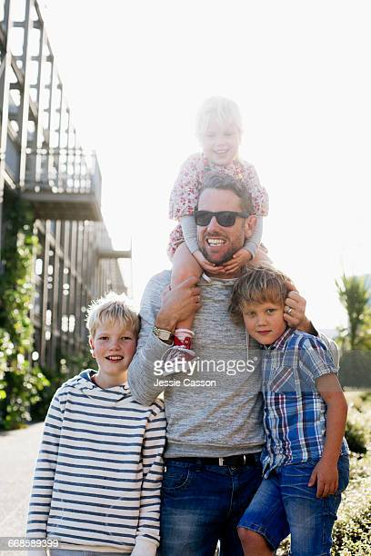 Modern father outside with children