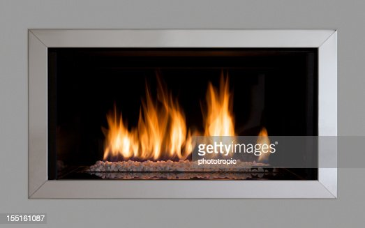 modern fireplace set in a wall