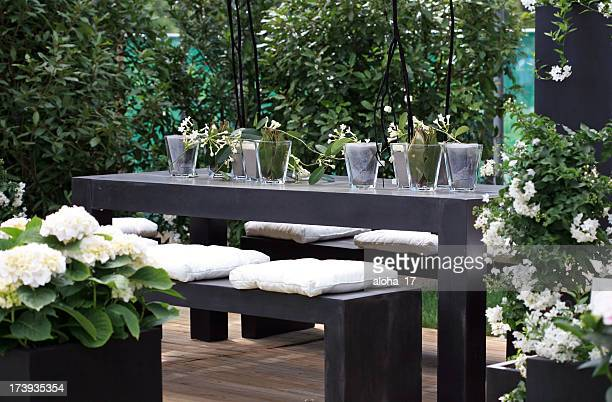 Modern furniture on outside deck with white flowers