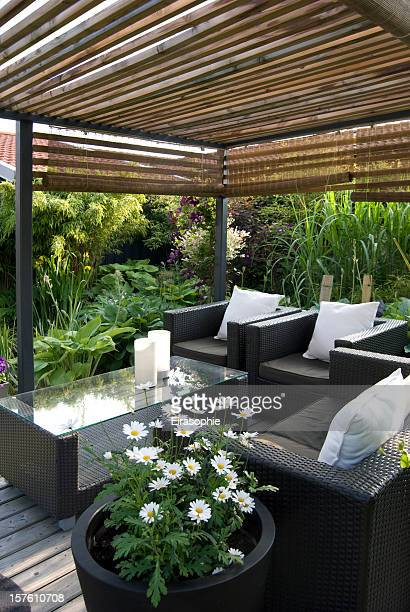 Modern Garden with a pergola and wicker sofa