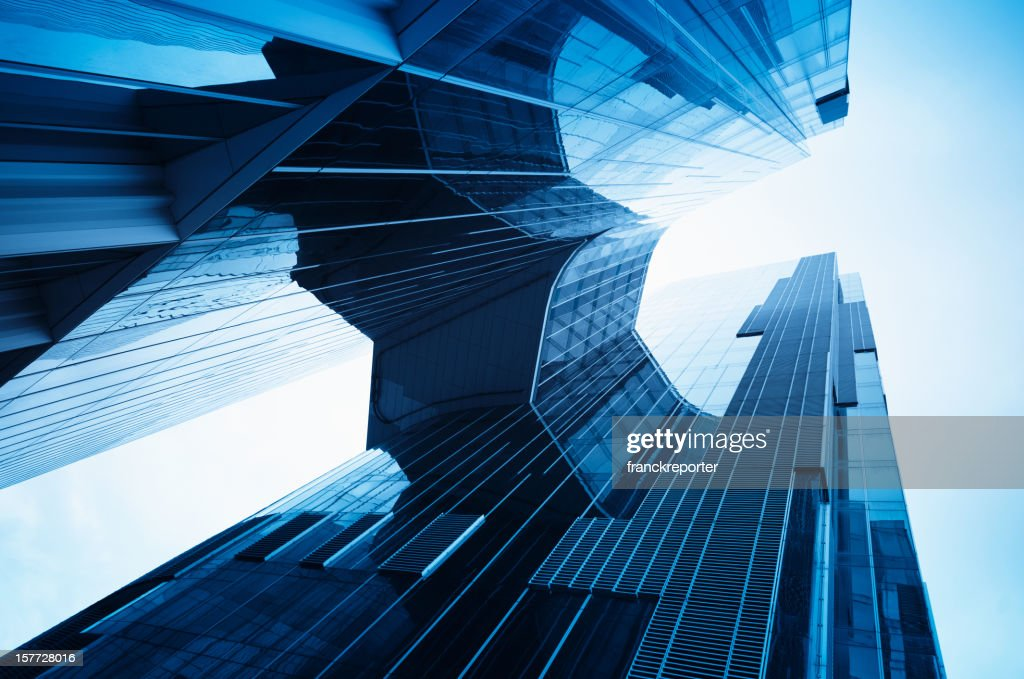Modern glass building in blue tone : Stock Photo