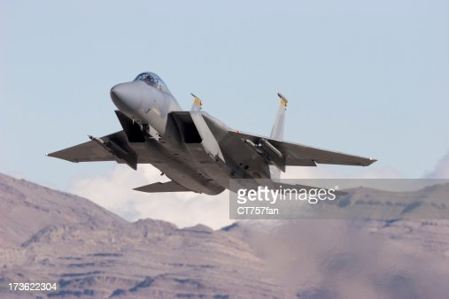 Modern Gray Jet Fighter with Mountains in the Background