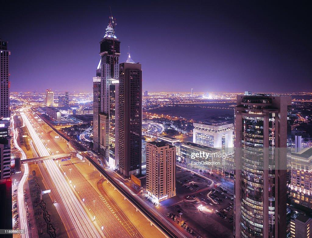 Modern high-rise buildings in Dubai at dusk. : Stock Photo