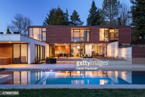 modern home exterior taken at twilight stock photo | getty images