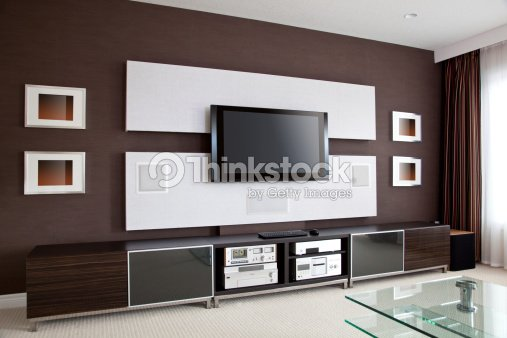 Modern home theater room interior with flat screen tv for Wohnzimmergestaltung wand