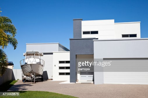 Modern home with boat and blue sky stock photo getty images for Blue modern house