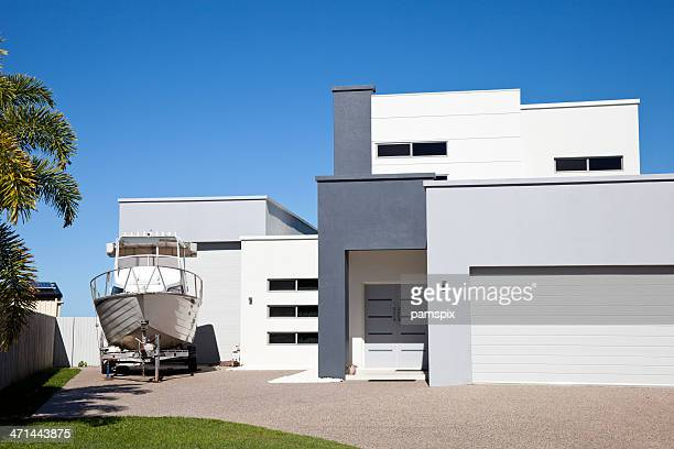 Modern Home with Boat and blue sky