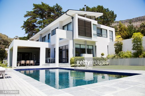 Modern home with swimming pool   Stock Photo. Modern Home With Swimming Pool Stock Photo   Getty Images