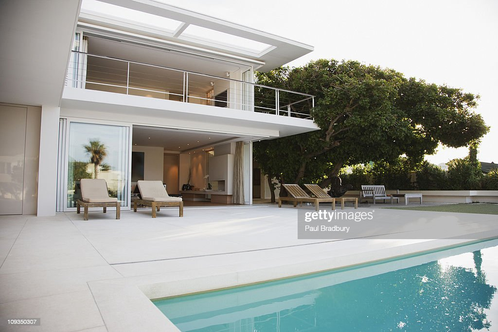 Modern House And Patio Next To Swimming Pool Stock Photo