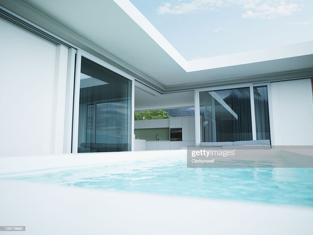 Modern house and swimming pool : Stock Photo