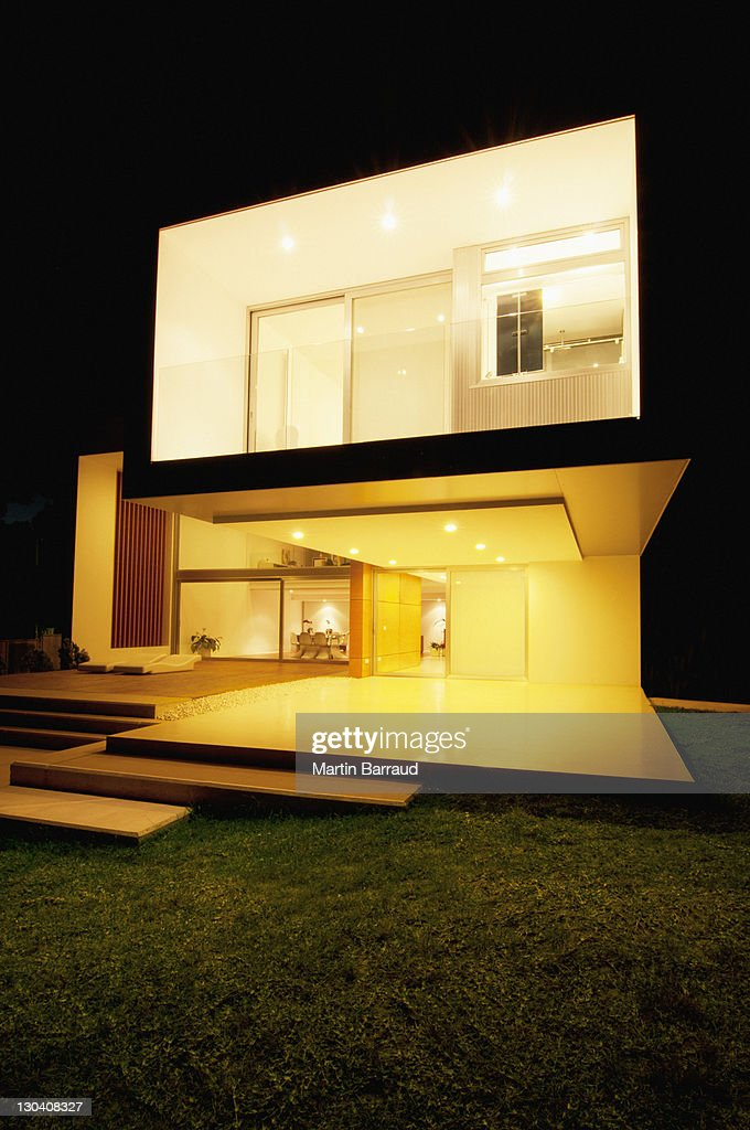 modern house lit up at night stock photo getty images. Black Bedroom Furniture Sets. Home Design Ideas