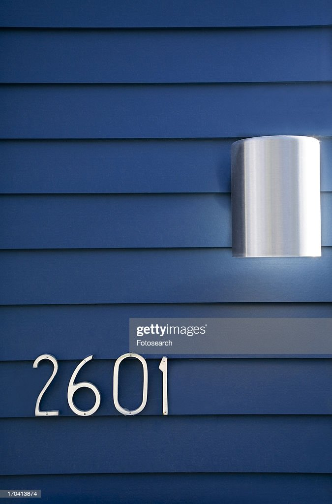 Modern House Numbers And Light On Blue Siding Stock Photo Getty