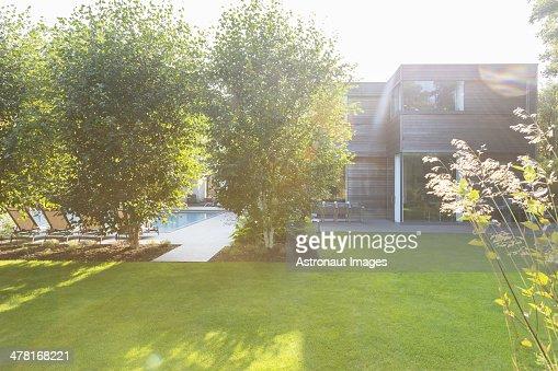 Modern house overlooking sunny backyard