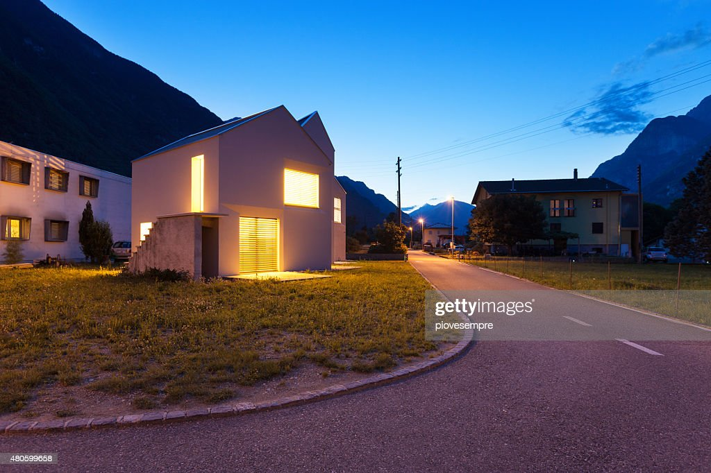 modern houses by night : Stock Photo