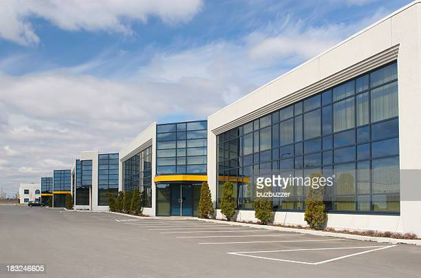 Consumerism stock photos and pictures getty images for Factory exterior design