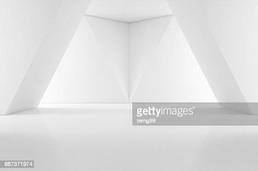Design intérieur moderne de showroom avec plancher vide et un fond de mur blanc : Photo