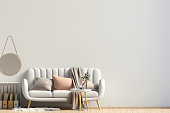 Modern interior with coffee table and sofa. Wall mock up. 3d illustration.