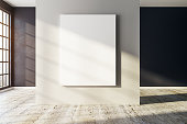 Modern concrete interior with empty billboard and city view with sunlight. Mock up, 3D Rendering