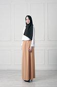 modern Islamic Muslim woman in fashionable dress in full growth, Tatarstan
