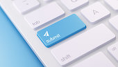 High quality 3d render of a modern keyboard with blue submit button on a blue background and copy space. The blue submit keyboard button has a text and an icon on it. The submit keyboard button is  in