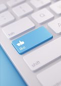 High quality 3d render of a modern keyboard with Thumbs Up Like button on a blue background and copy space. The keyboard button has a text  and an icon on it. The keyboard button is  in focus, Great u