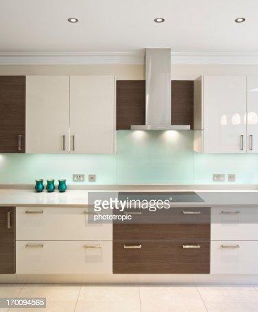 Modern kitchen in walnut and cream