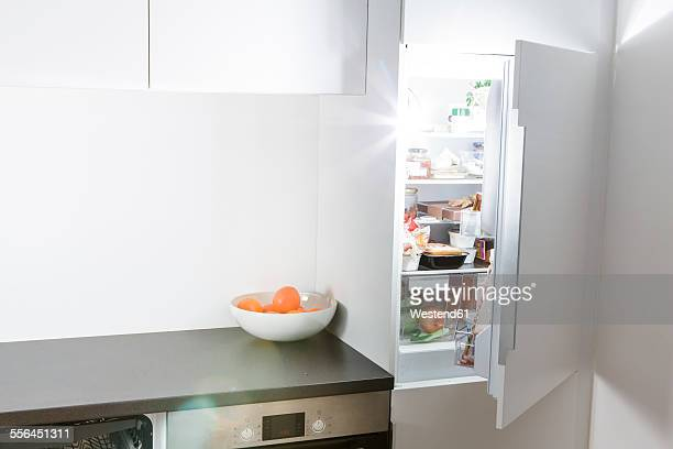 Modern kitchen, open fridge and light