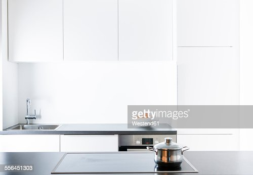 Modern kitchen, pot on cooker