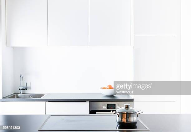Modern kitchen, pot on cooker