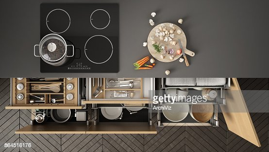 Modern Kitchen Top View Opened Drawers And Stove With Cooking Pan