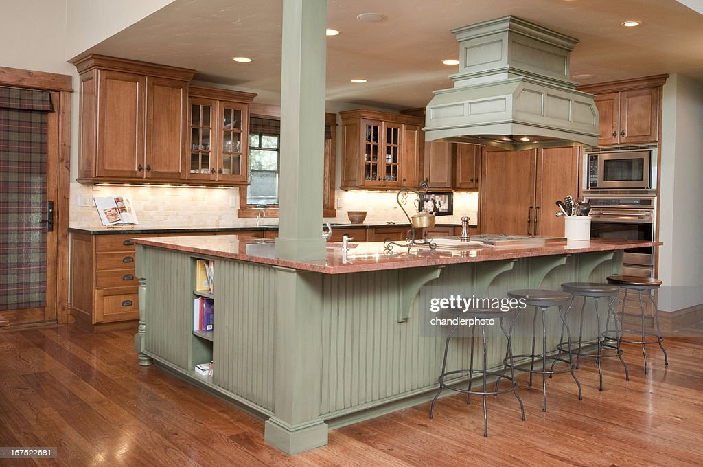 A Modern Kitchen With An Island Seating Area : Stock Photo