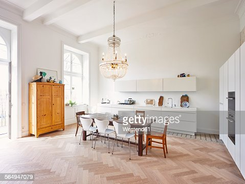 Modern kitchen with dining table in a refurbished old building