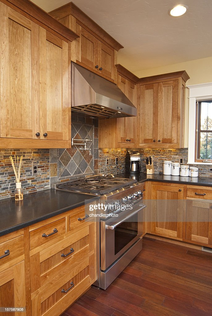 Modern kitchen with hardwood floors & stainless steel stove