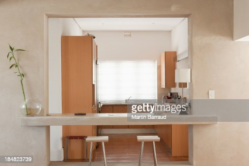 Modern kitchen with stools : Stock Photo