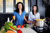Modern Kitchen Young Women having fun cooking together