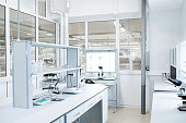 Interior of empty  science laboratory with modern equipment, copy space