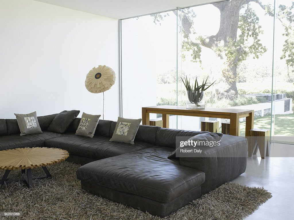 Modern living room and glass wall in modern home : Stock Photo