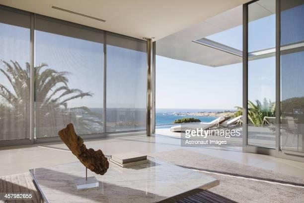 Modern living room and patio overlooking ocean