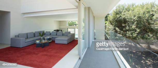 Modern living room open to balcony