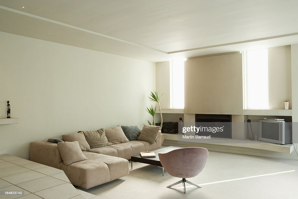 Modern living room with large fireplace : Stock Photo