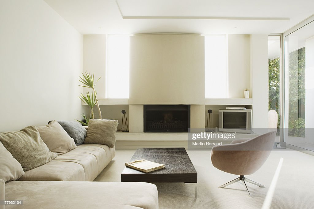 Modern living room with large fireplace stock photo for Large modern living room