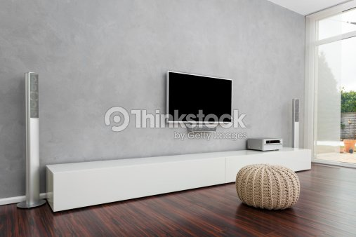 Modern living room with tv stock photo thinkstock for Ikea meuble mural besta